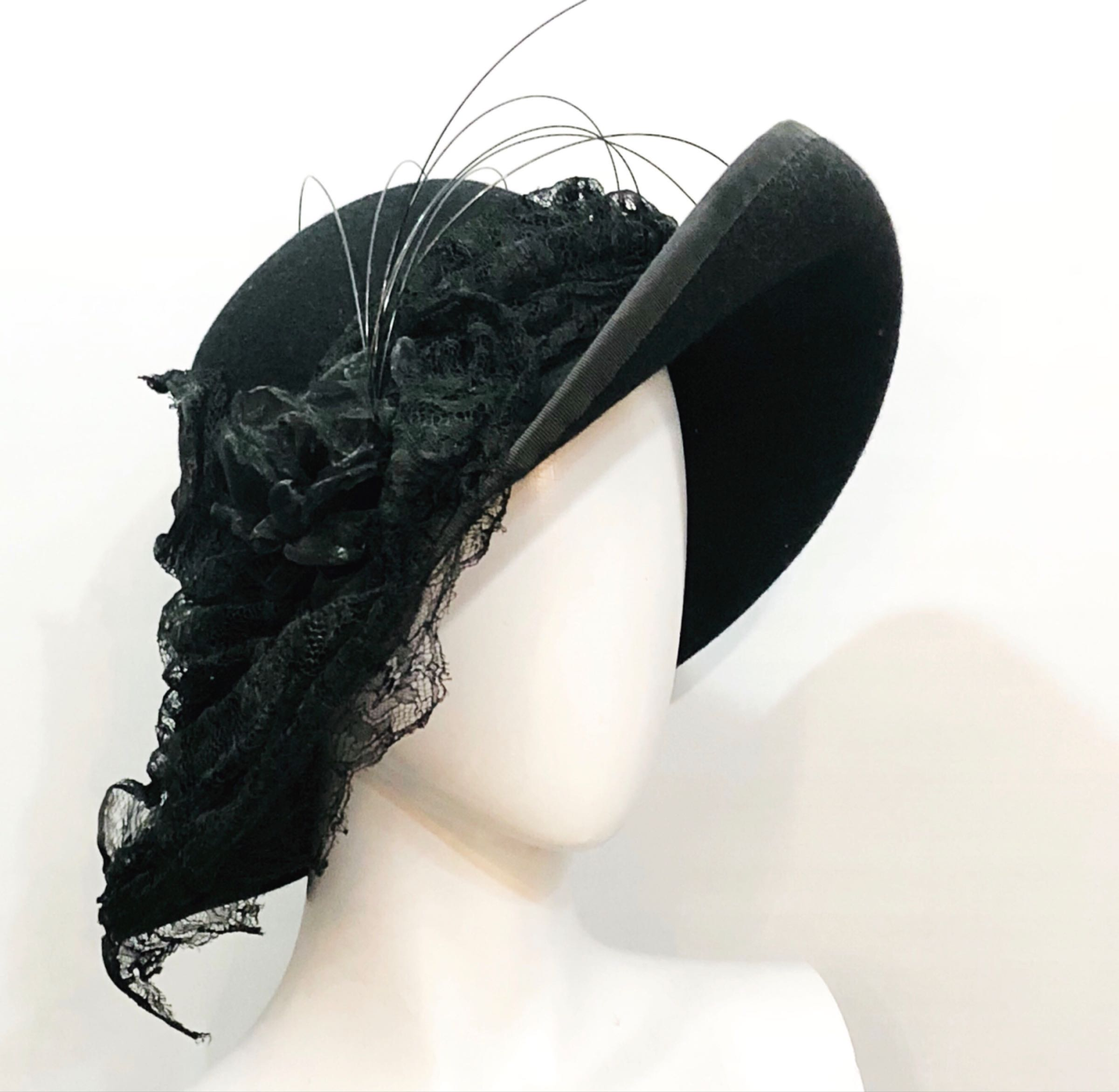Wide brimmed black felt with lace