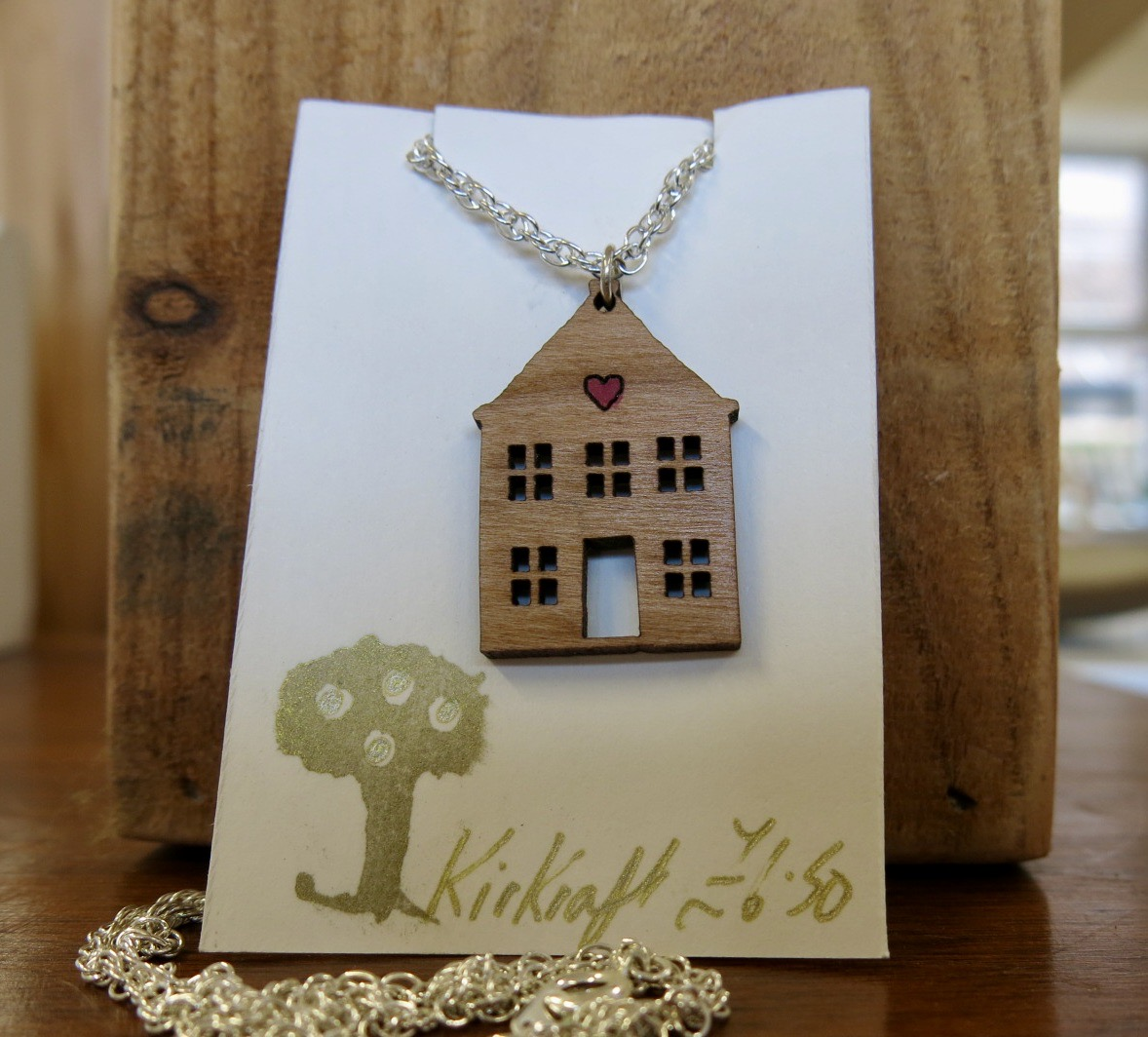 WOODEN HOUSE WITH HEART NECKLACE