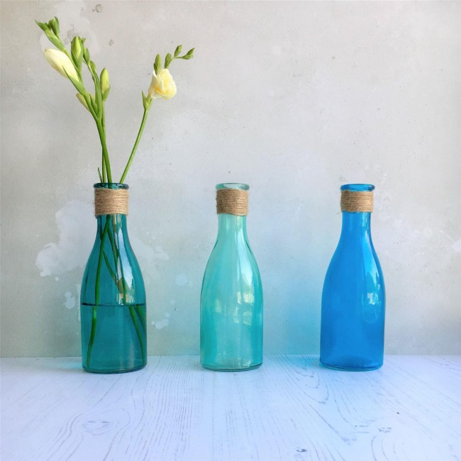 Blue glass bottles set