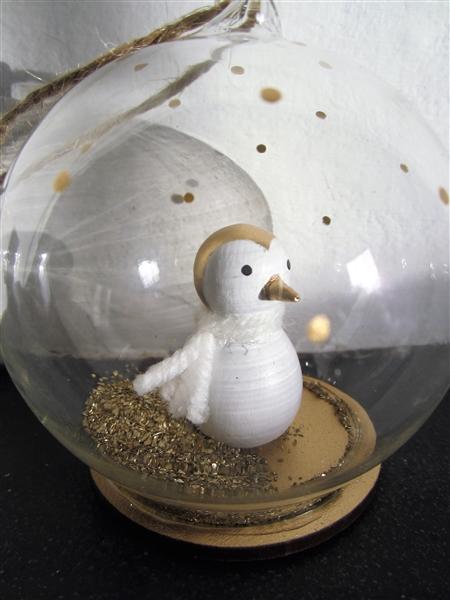 Golden Penguin Snow globe