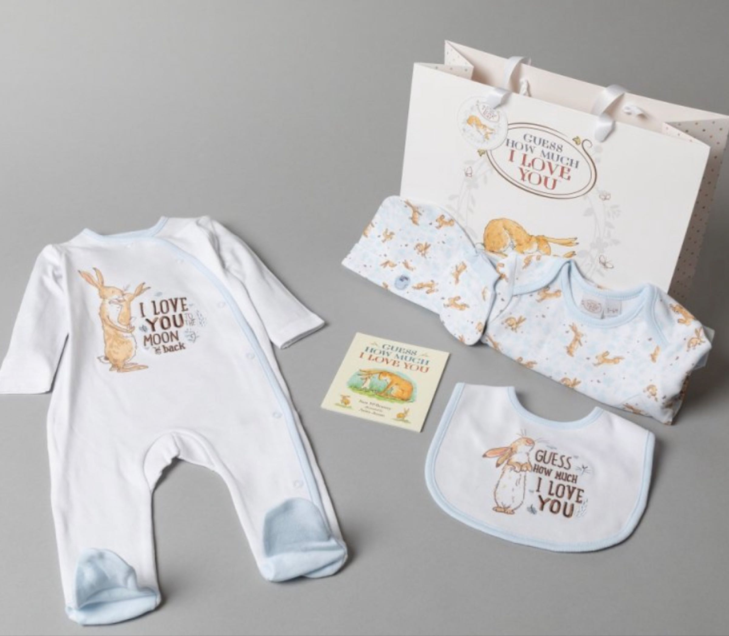 Guess How Much I Love You Layette Gift Bag Set   -grey  includes sleepsuit, bodysuit, mitts, bib, hat, book and gift bag - Blue
