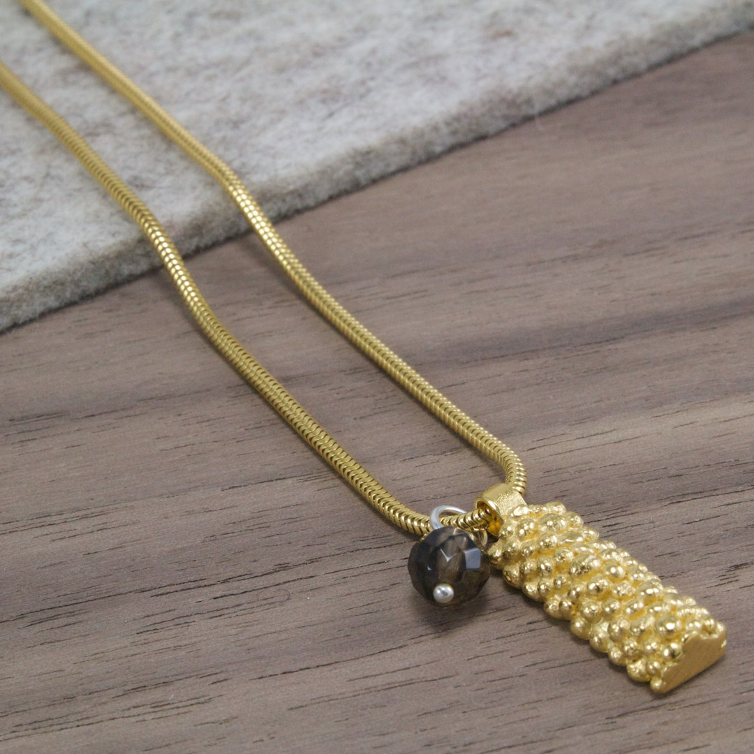 Bobbled Pendant; oblong with pearl or stone.
