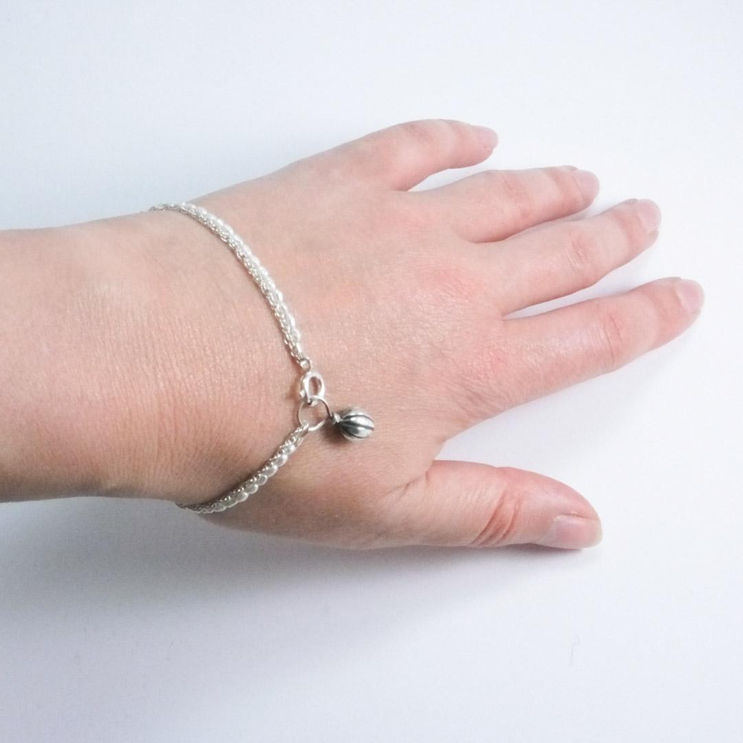 Pod Bracelet: white pearls.