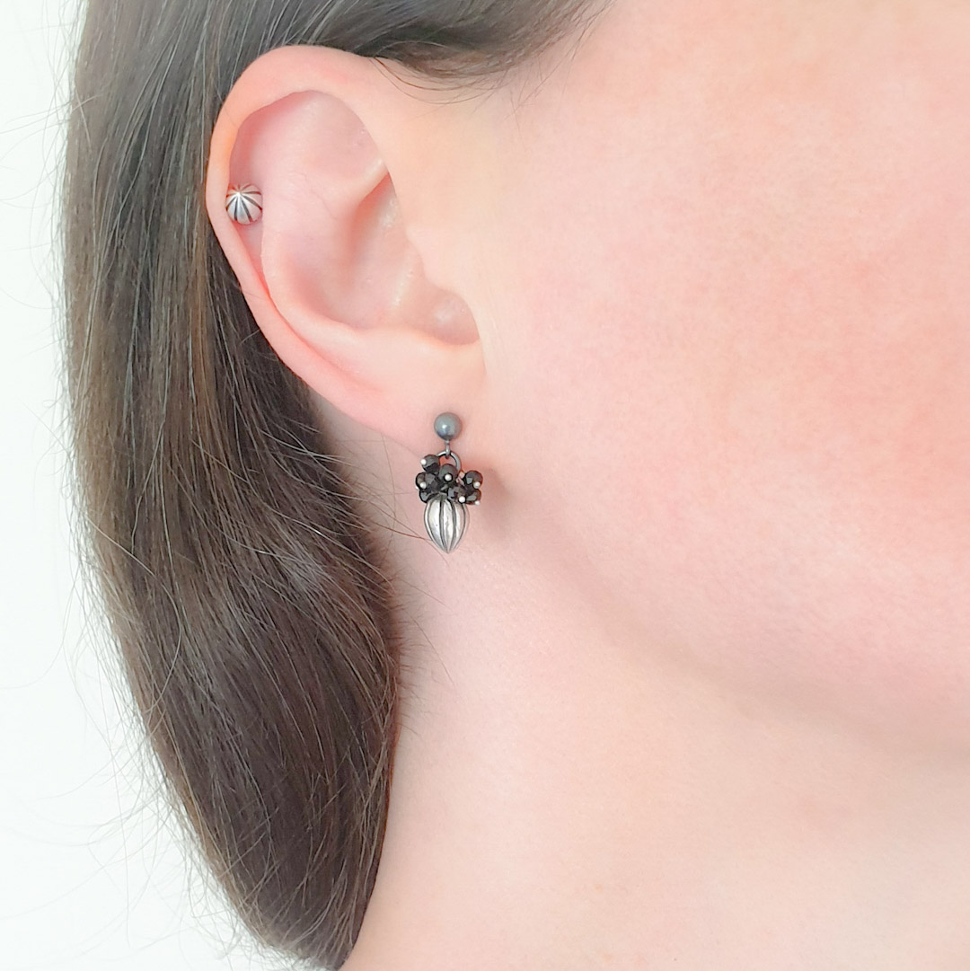 Pod Earrings: black spinels.