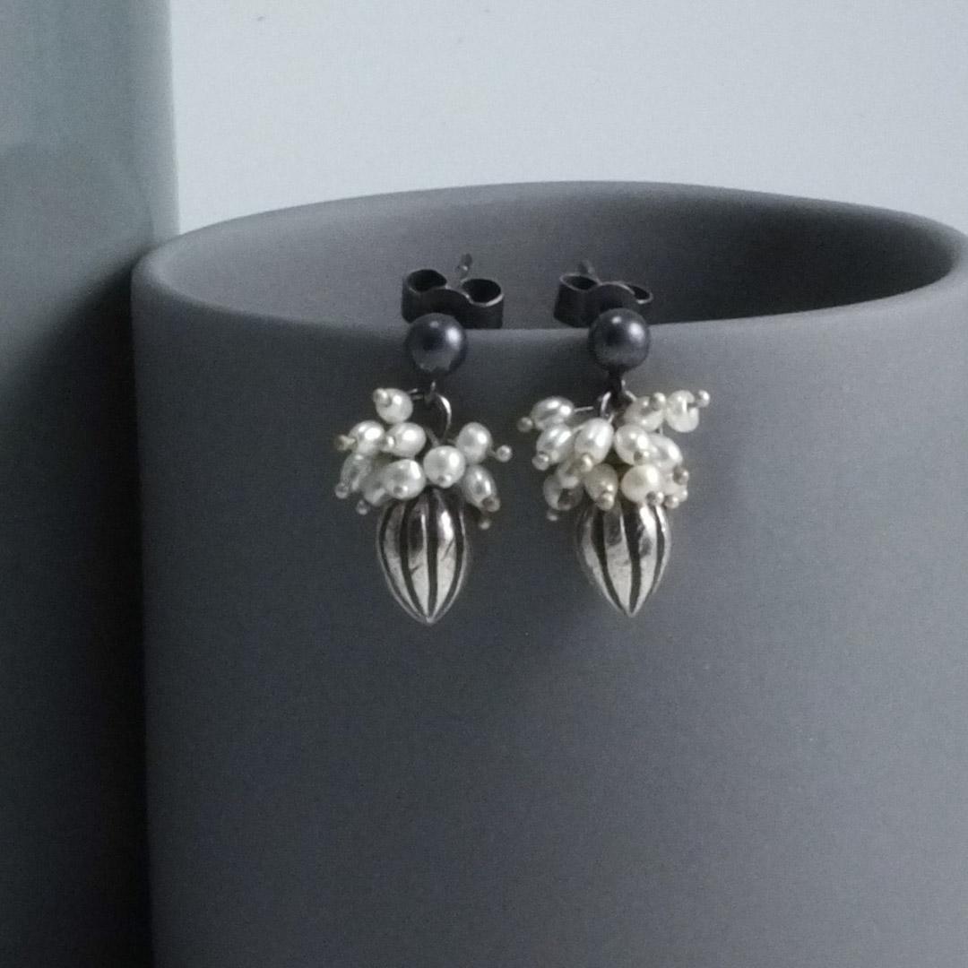 Pod Earrings: white pearls.