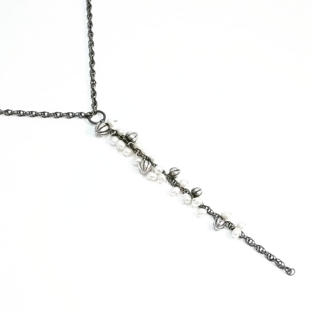 Tiny Pod Cascade Necklace: oxidised silver and white pearls.