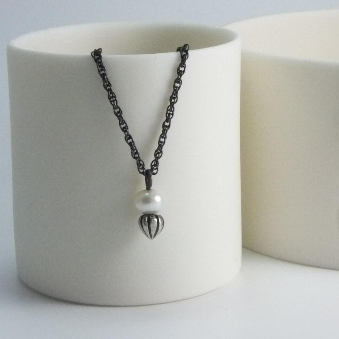 Tiny Pod Pendant: white pearl.