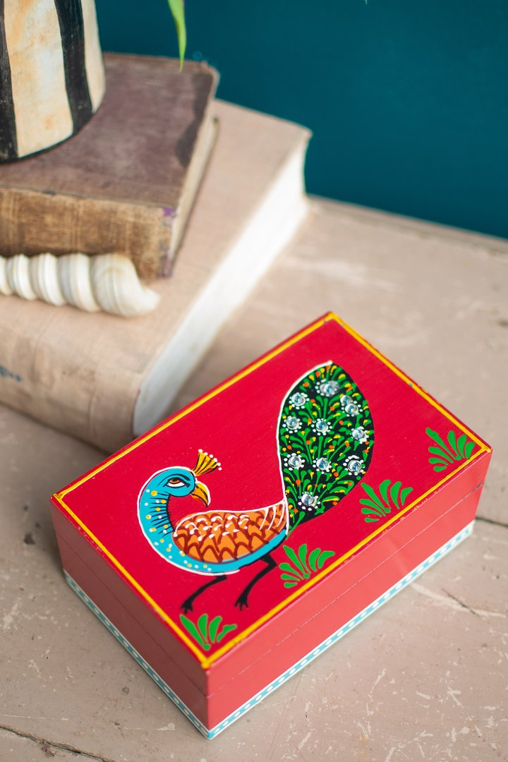 Red rectangle box w peacock by Ian Snow