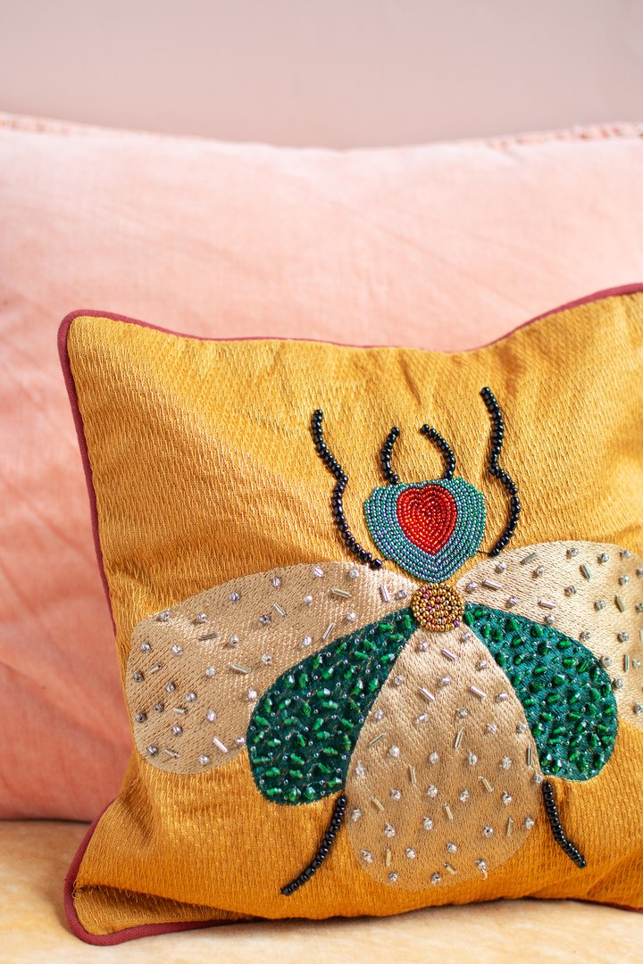 Embroidered fly cotton cushion by Ian Snow