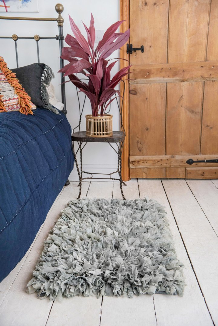 Grey recycled silk & crepe shaggy rug by Ian Snow