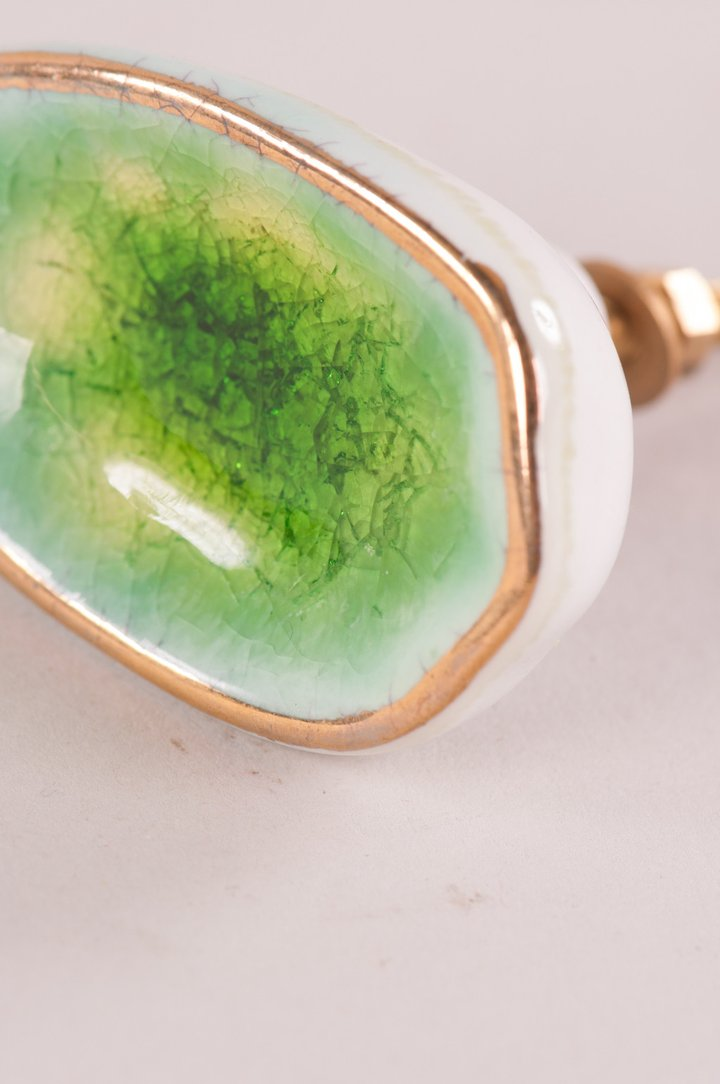 Green ceramic door knob with gold edge by Ian Snow
