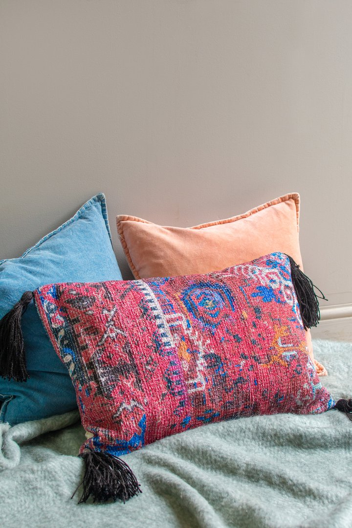 Jerome chenille cushion with large tassels by Ian Snow