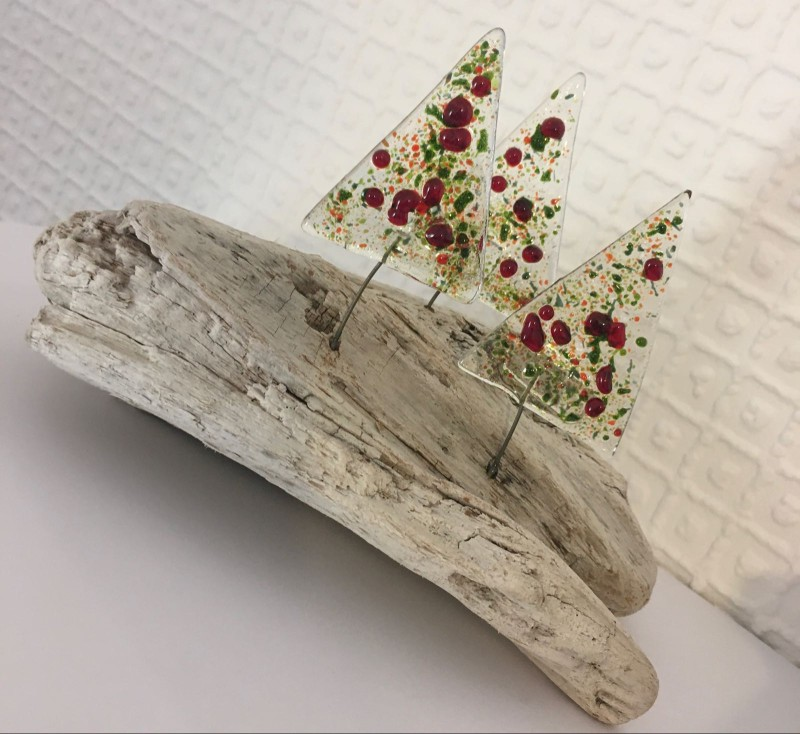 Fused glass Christmas trees on beach driftwood