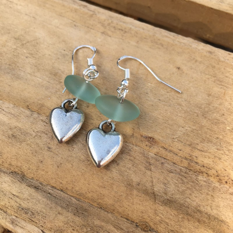 Fused glass heart earrings . Silver wires.