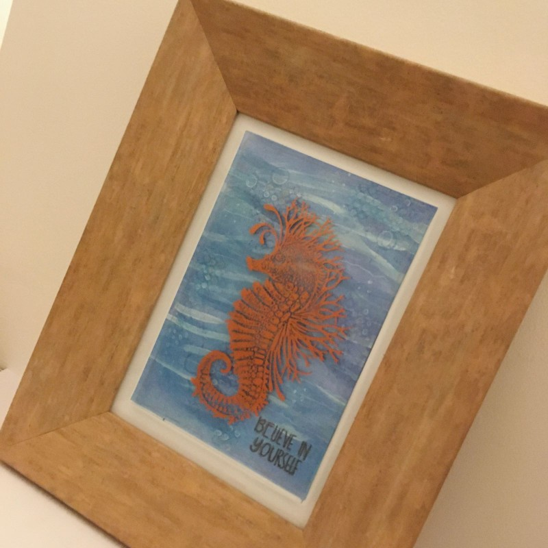 Copper printed fused glass seahorse frame