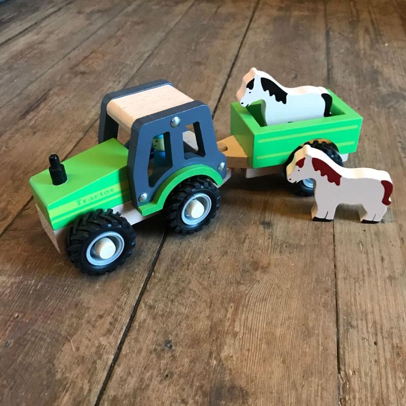 Leke i tre : traktor med henger og dyr
