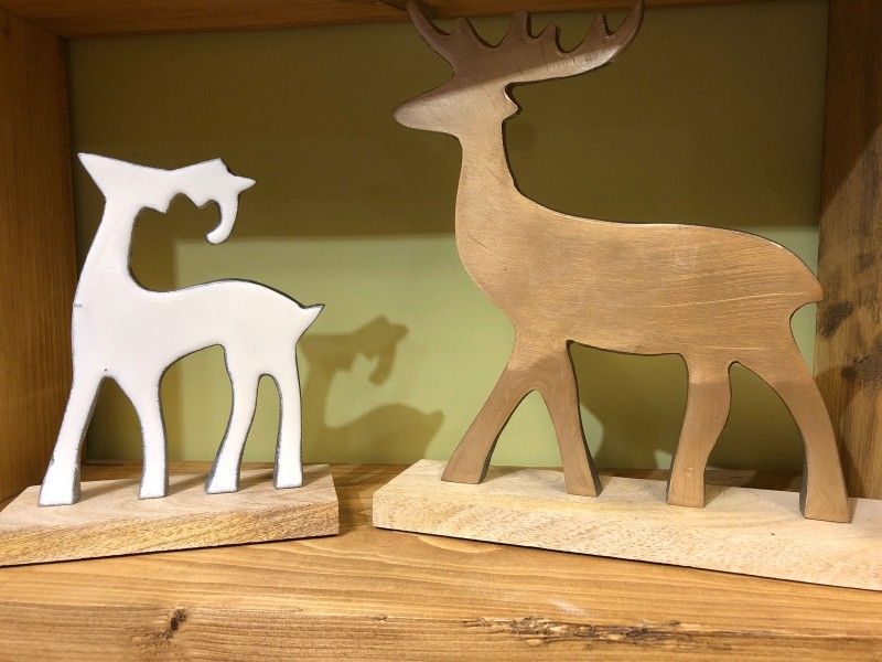 Deer on wooden base