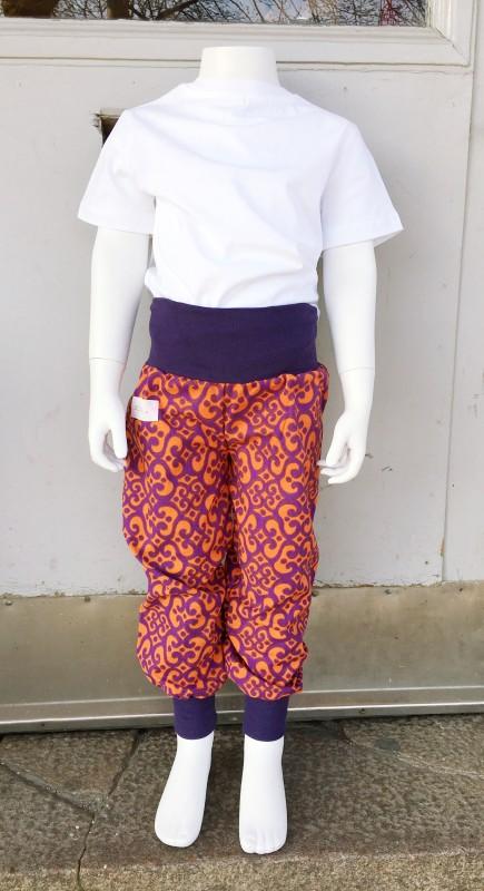 Children´s pants orange swirls