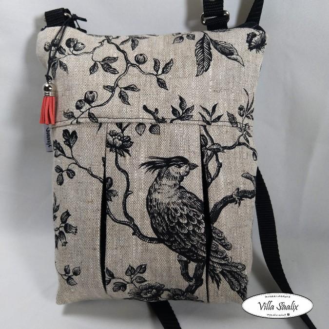 Pilkahdus-laukku Pellavalintu