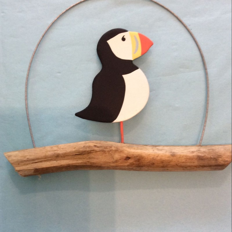 Puffin on driftwood