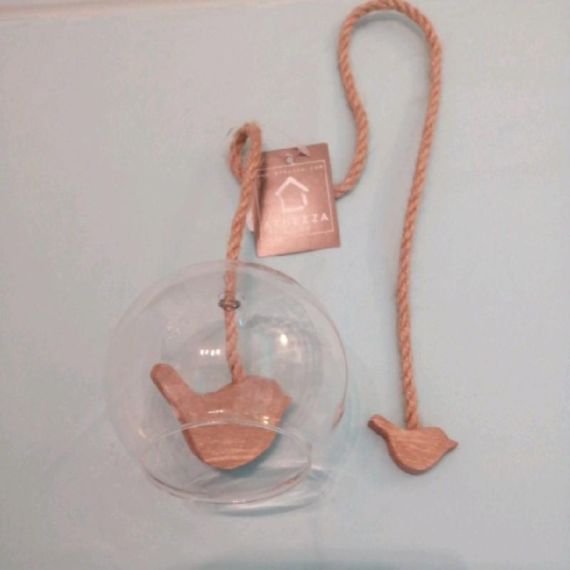 Bird in a glass bell