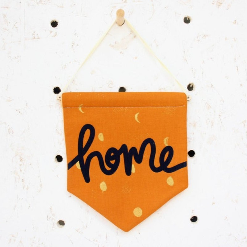 'Home' pennant flag (orange/navy) by Daphne Rosa
