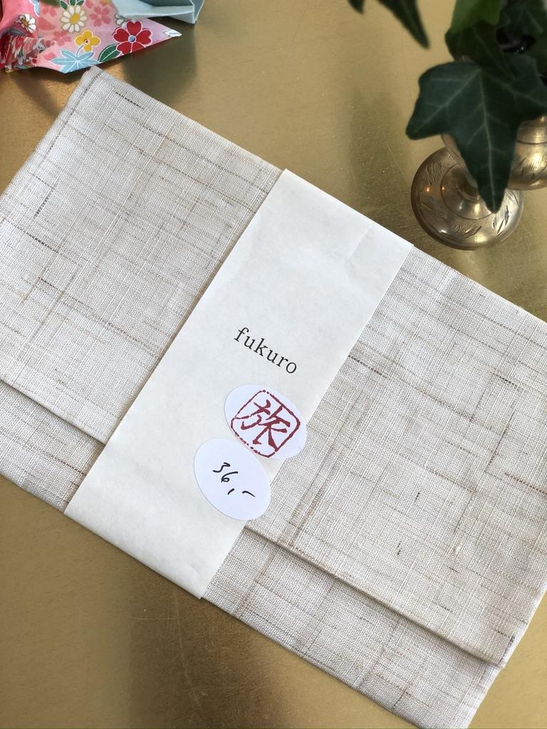 Pellavainen kirjekuorilaukku