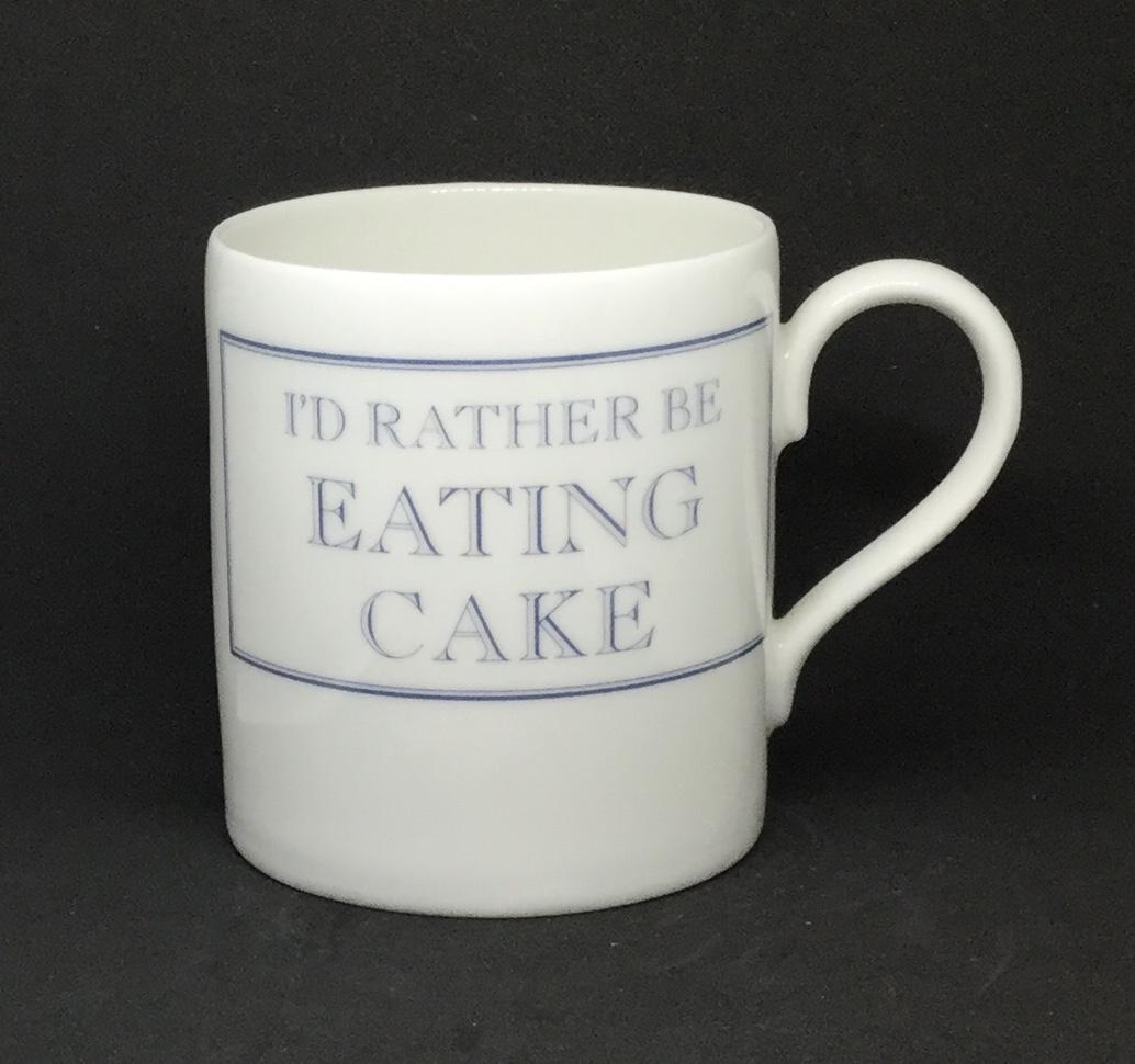 'I'd rather be' eating cake mug
