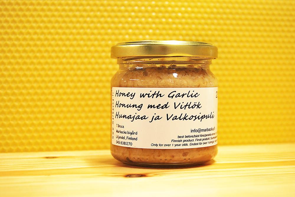 Valkosipulilla maustettua hunajaa 230 g, lasipurkki