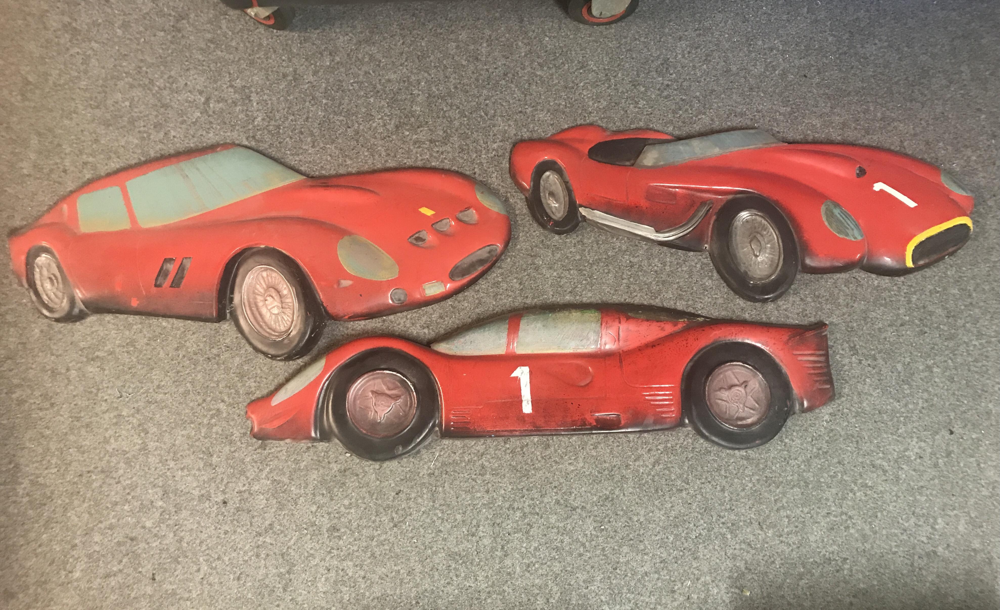 Set of relief Vintage Ferrari models in fiberglass