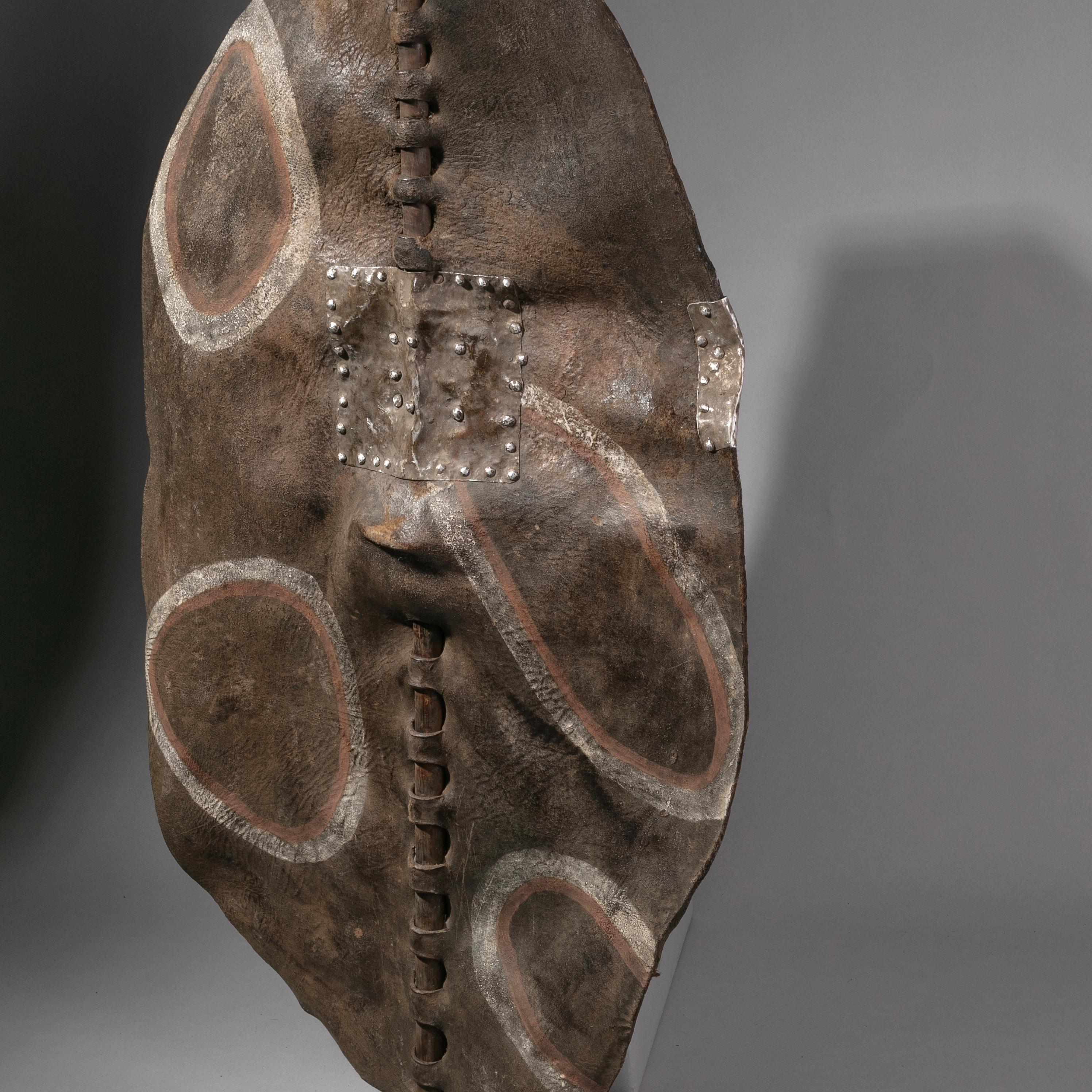 A DINKA LEATHER SHIELD WITH METAL REPAIR FROM SUDAN ( No 1221 )