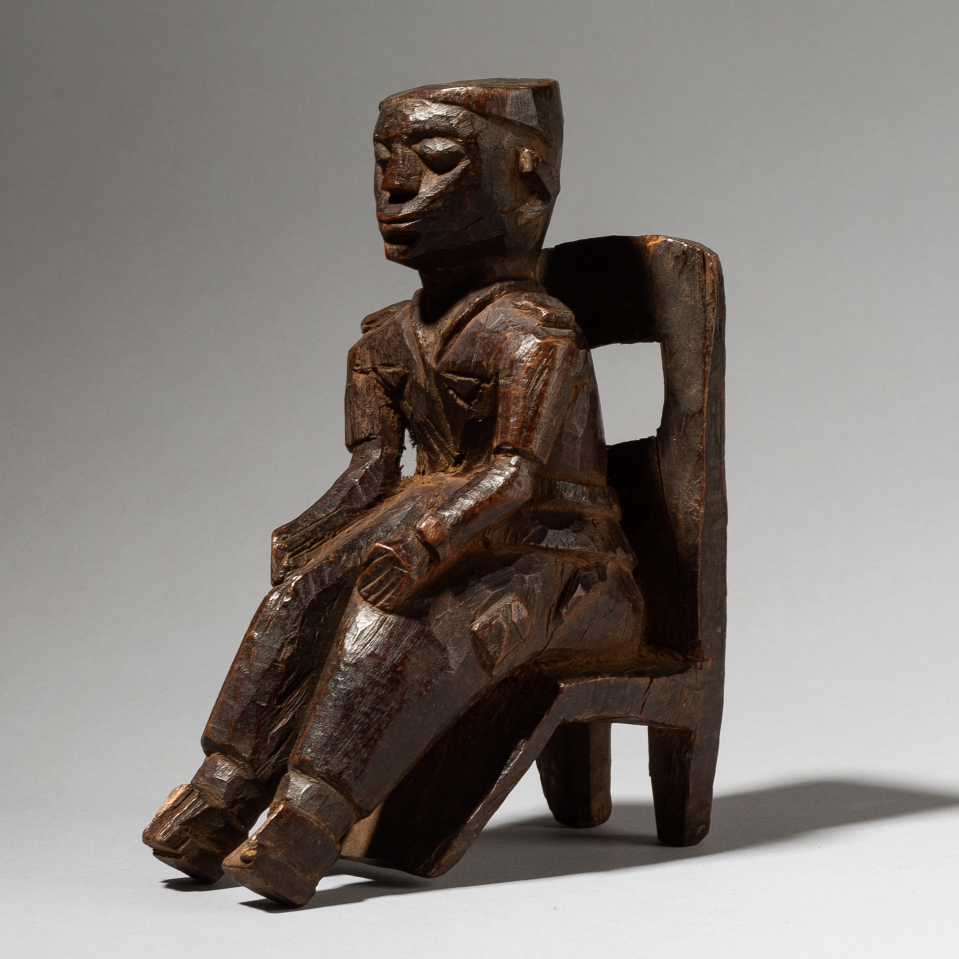A LOBI SEATED FIGURE FROM THE IVORY COAST W AFRICA ( No 4089)