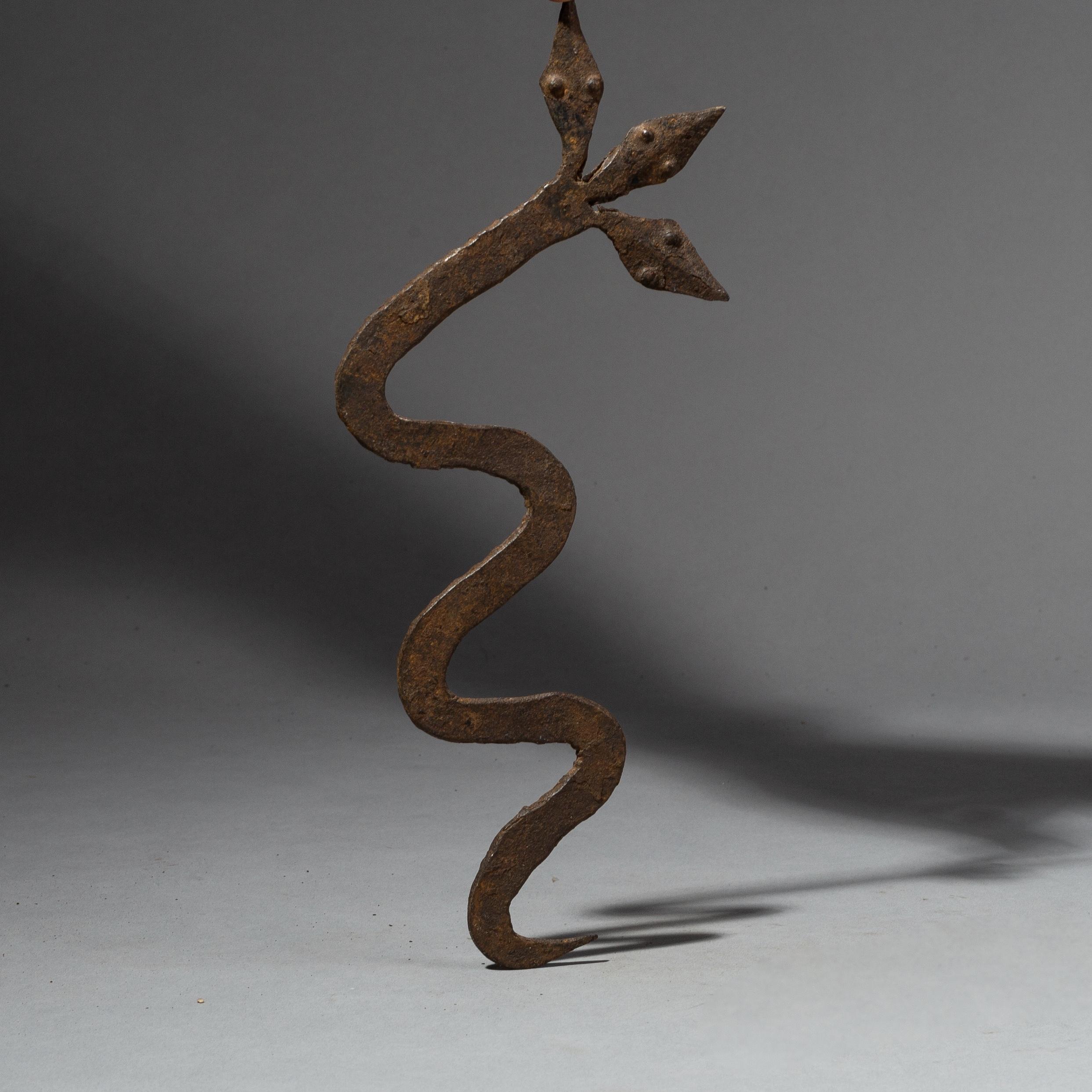 A TRIPLE HEADED LOBI IRON SNAKE CHARM FROM BURKINA FASO ( No 2087 )