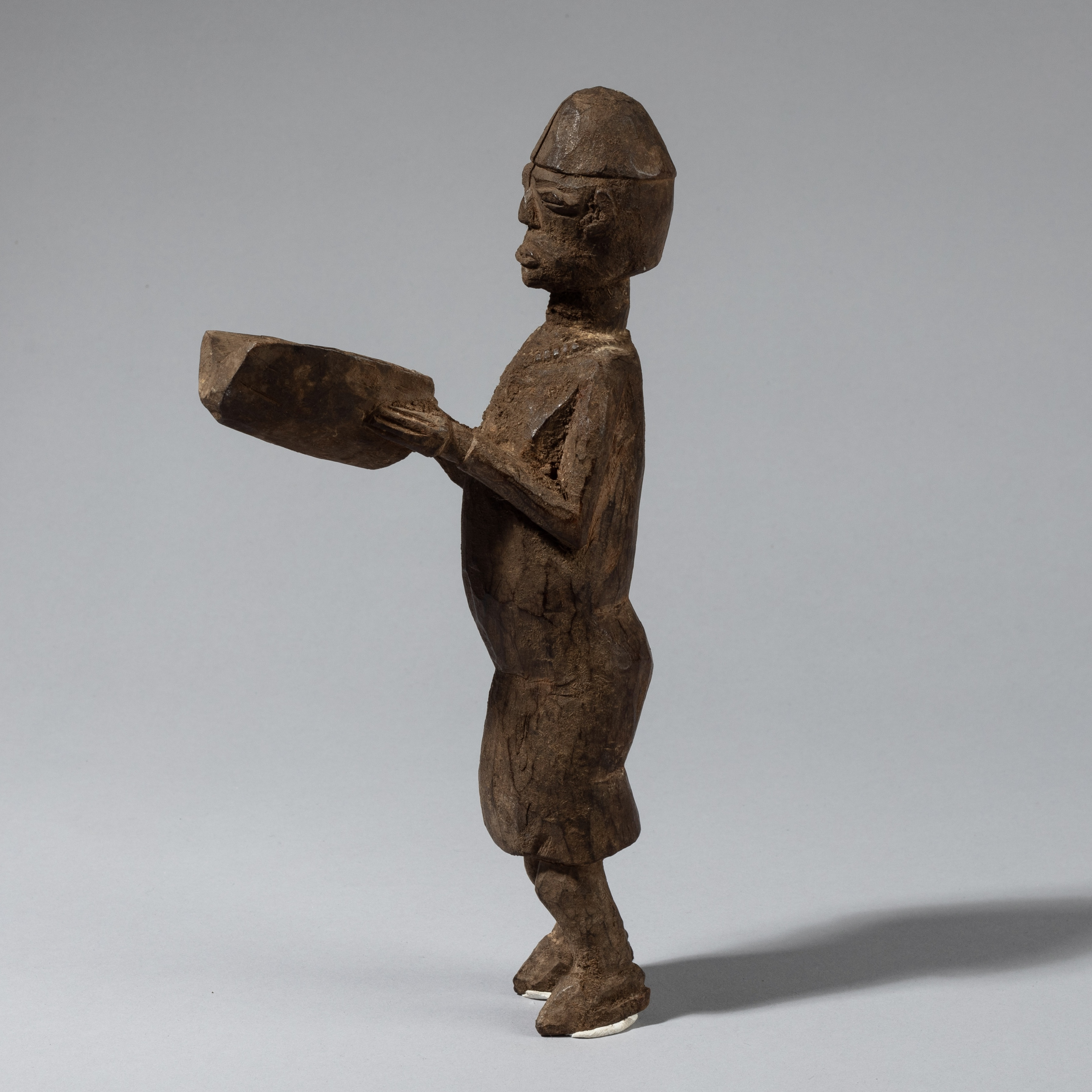 A SHOW STOPPING LOBI ALTAR FIGURE WITH BOOK, BURKINA FASO ( No 4329)