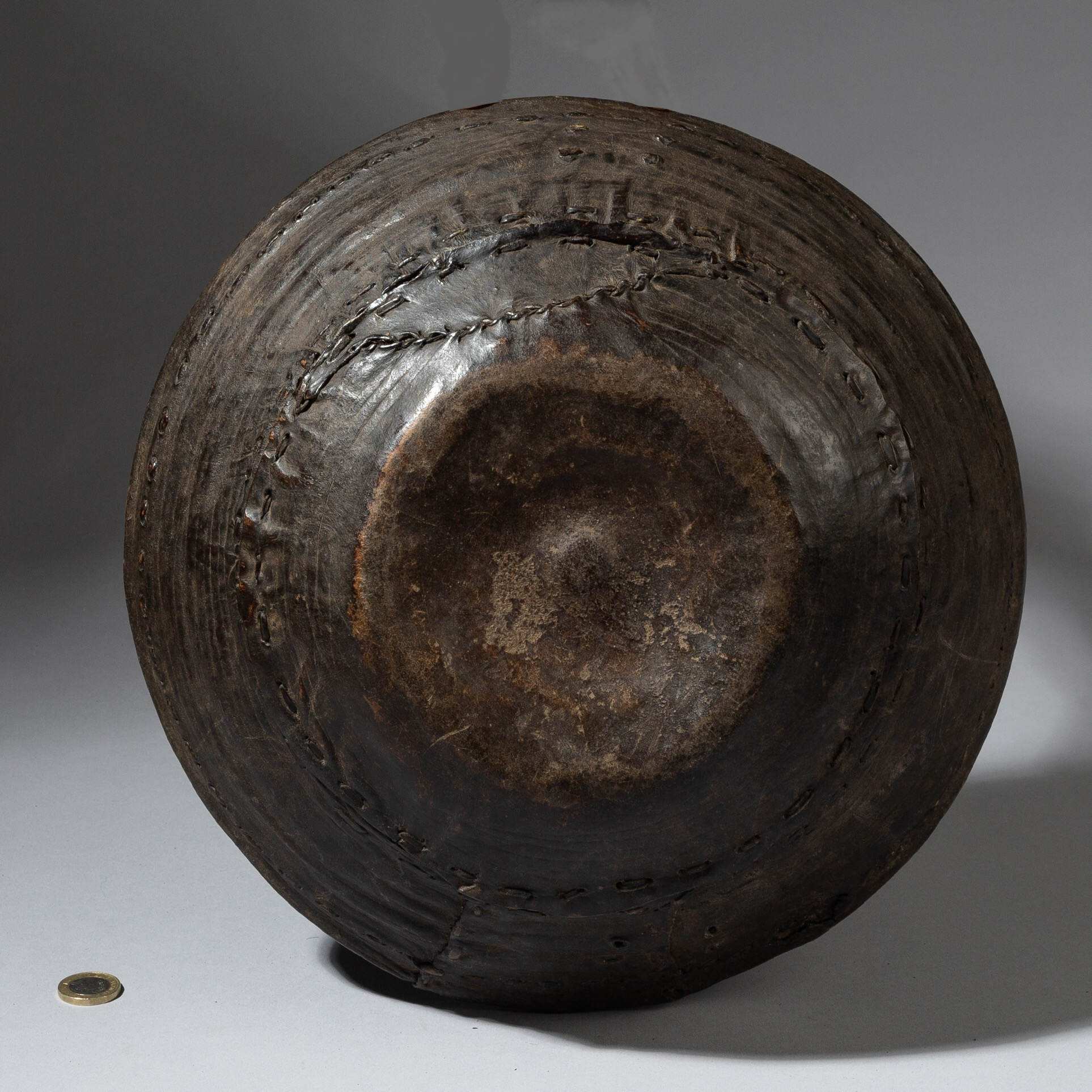 A HIGHLY PATINATED  LEATHER COVERED ETHIOPIAN BASKET ( No 3302 )