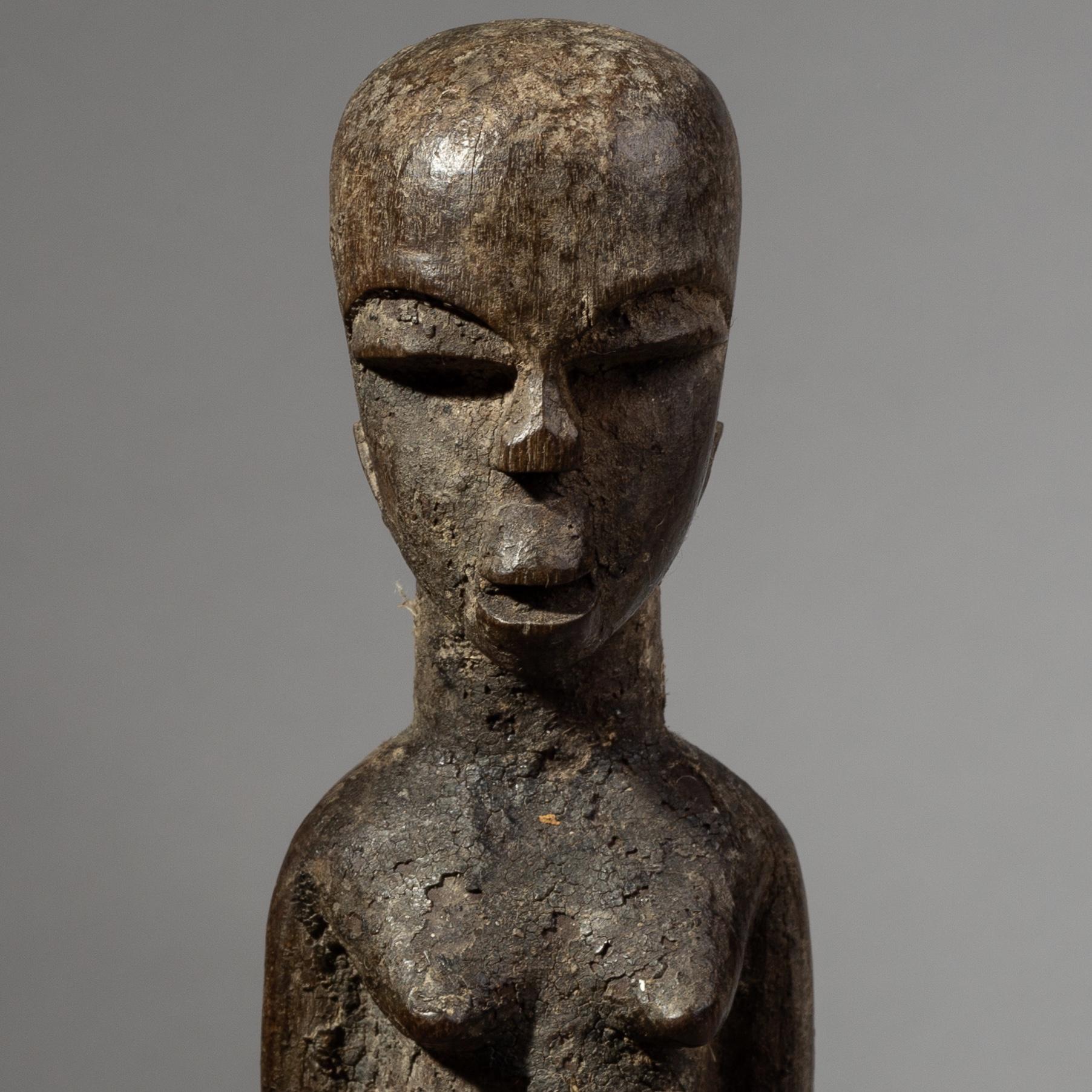 AN ENCRUSTED LOBI THIL FIGURE FROM BURKINA FASO ( No 1907 )