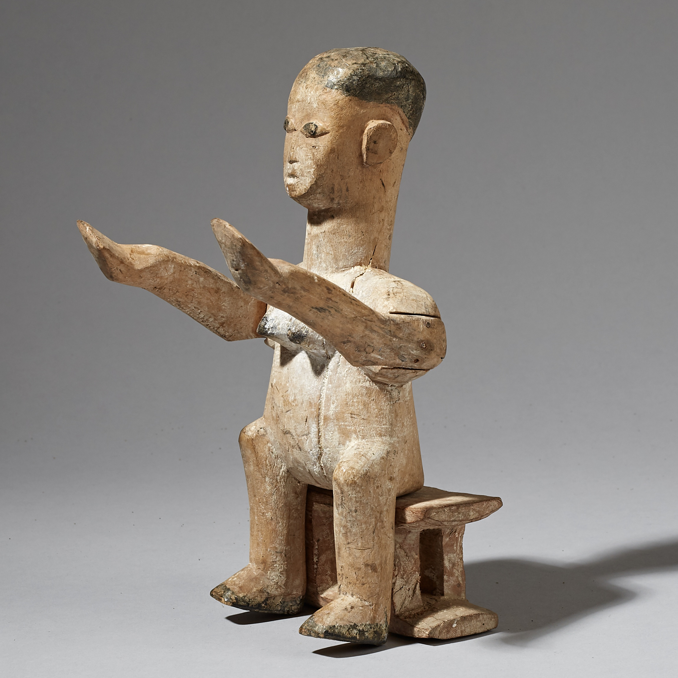 A SEATED EWE ALTAR FIGURE WITH OFFERING HANDS, FROM GHANA ( No 2944 )