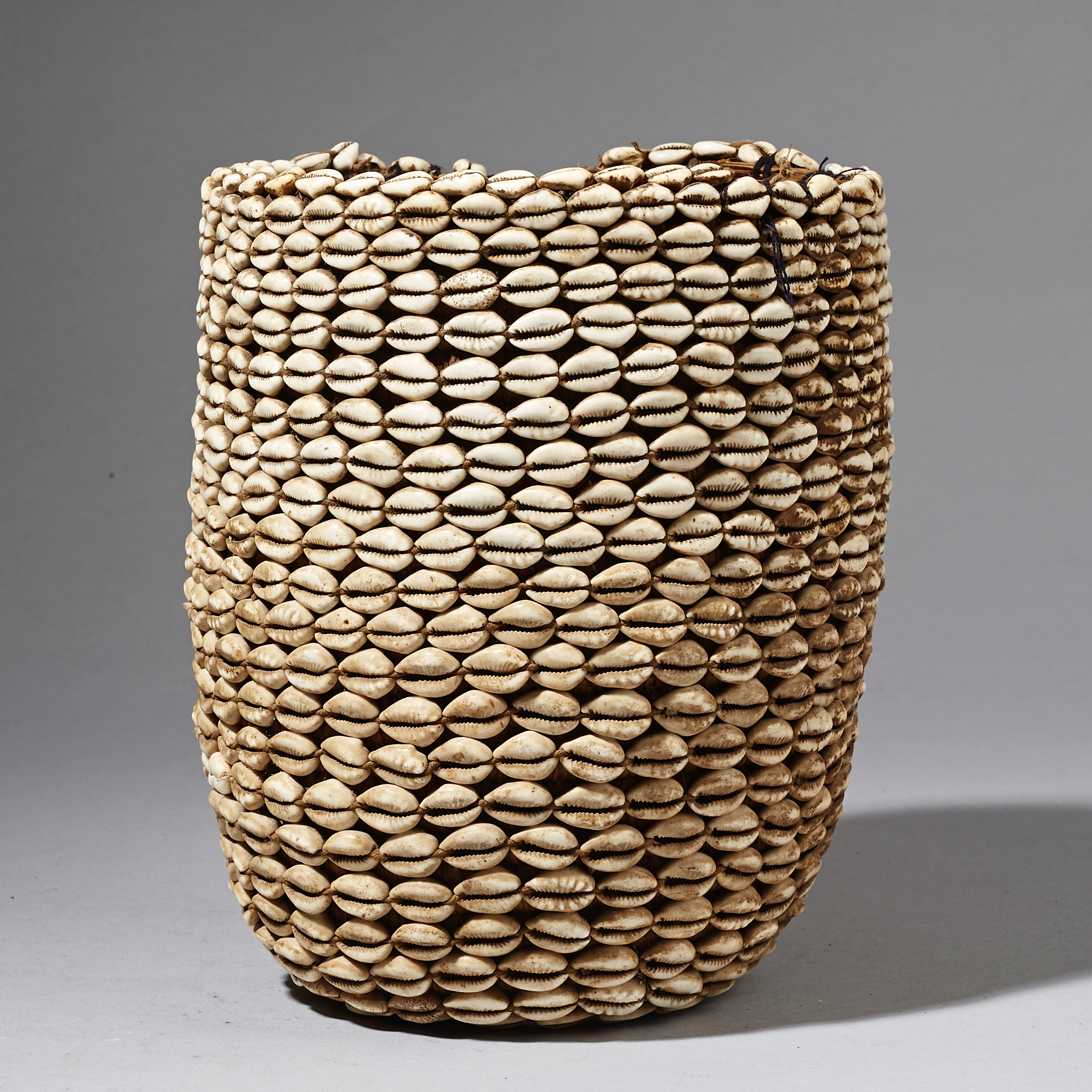 A GLORIOUS COWRIE COVERED BASKET FROM THE MOSSI TRIBE OF BURKINA FASO  ( No 2464 )