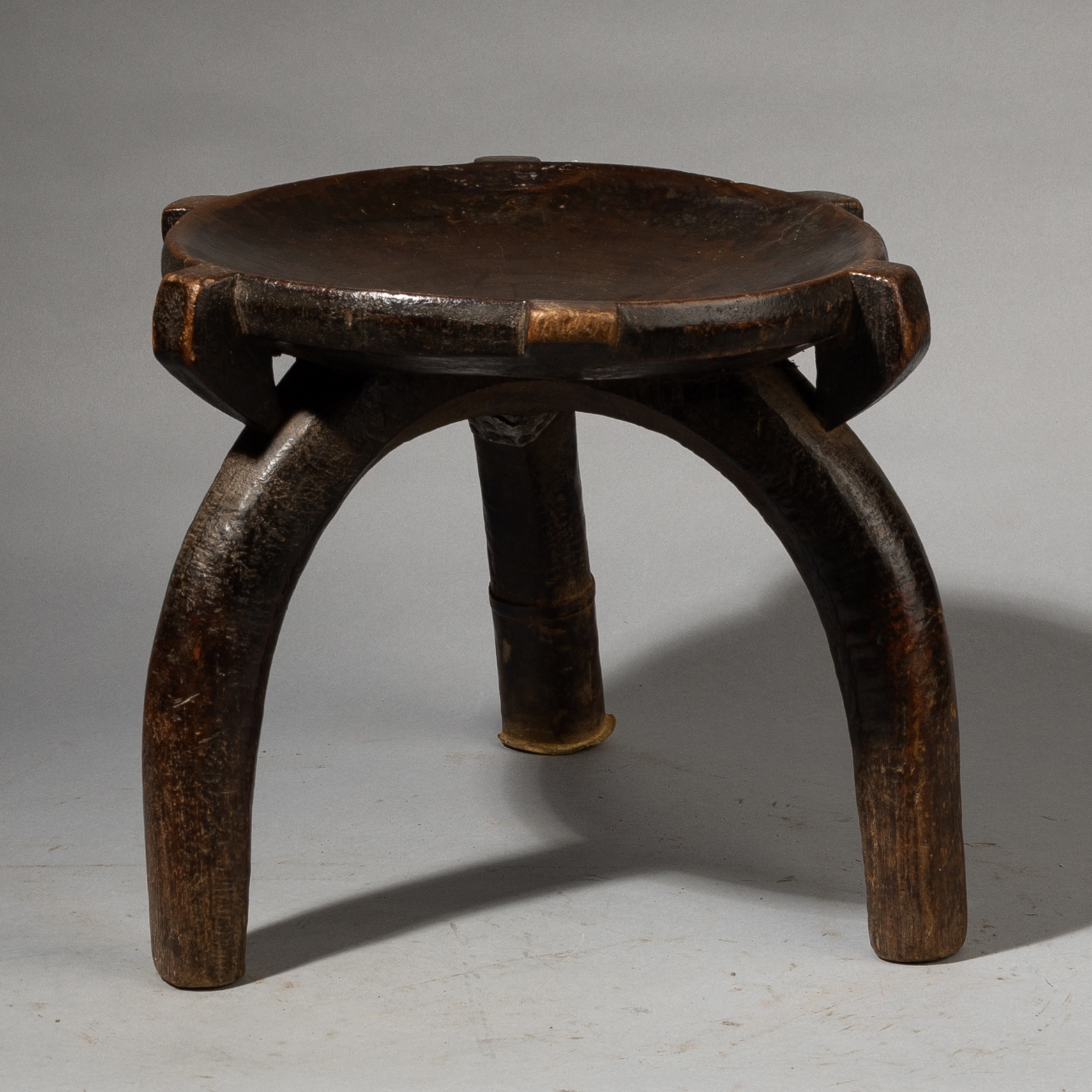 A SHAPELY GO GO TRIBE STOOL FROM TANZANIA WITH INTERESTING REPAIR ( No  3515)