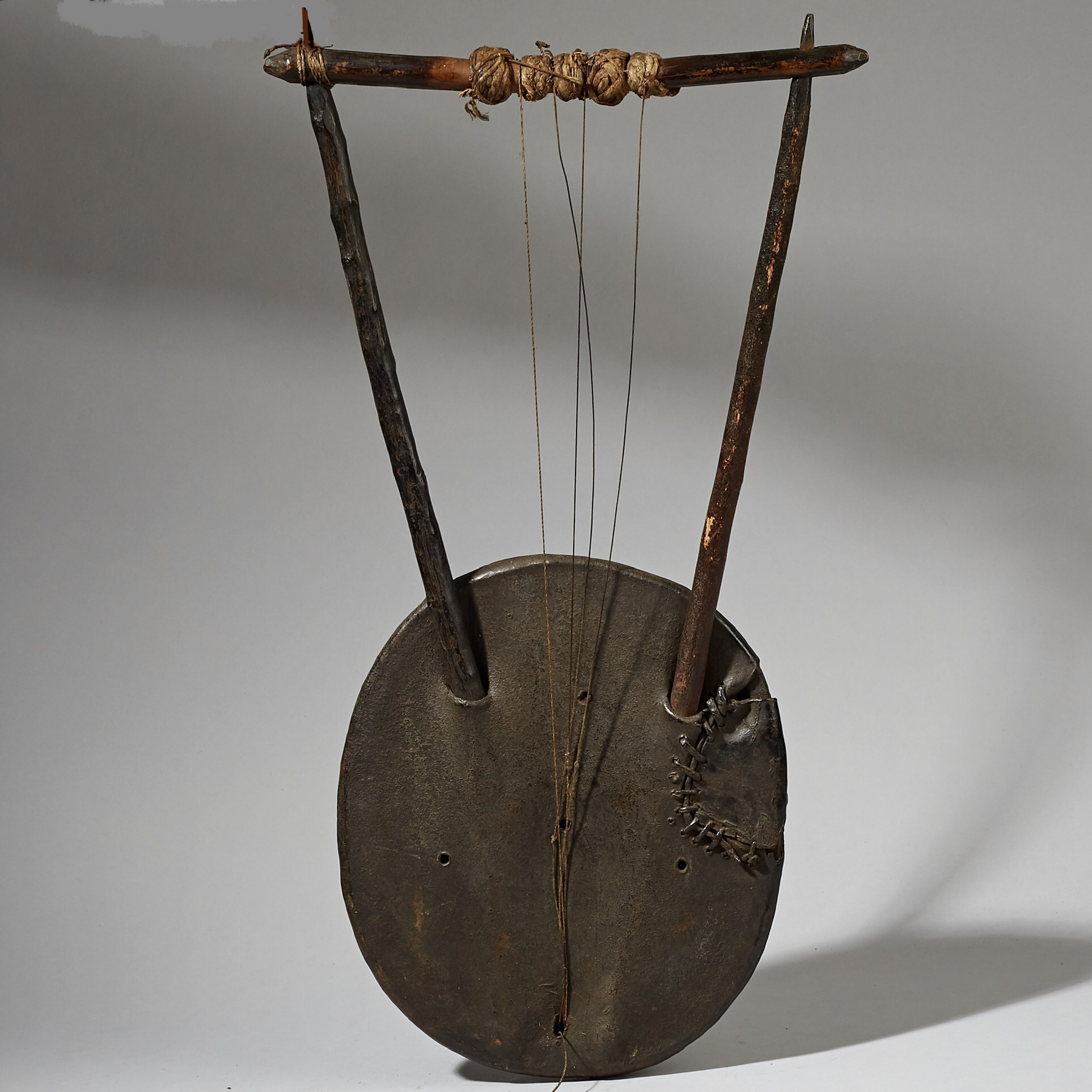 AN ENGRAVED MUSICAL INSTRUMENT FROM ETHIOPIA WITH STITCH REPAIR( No 3087 )
