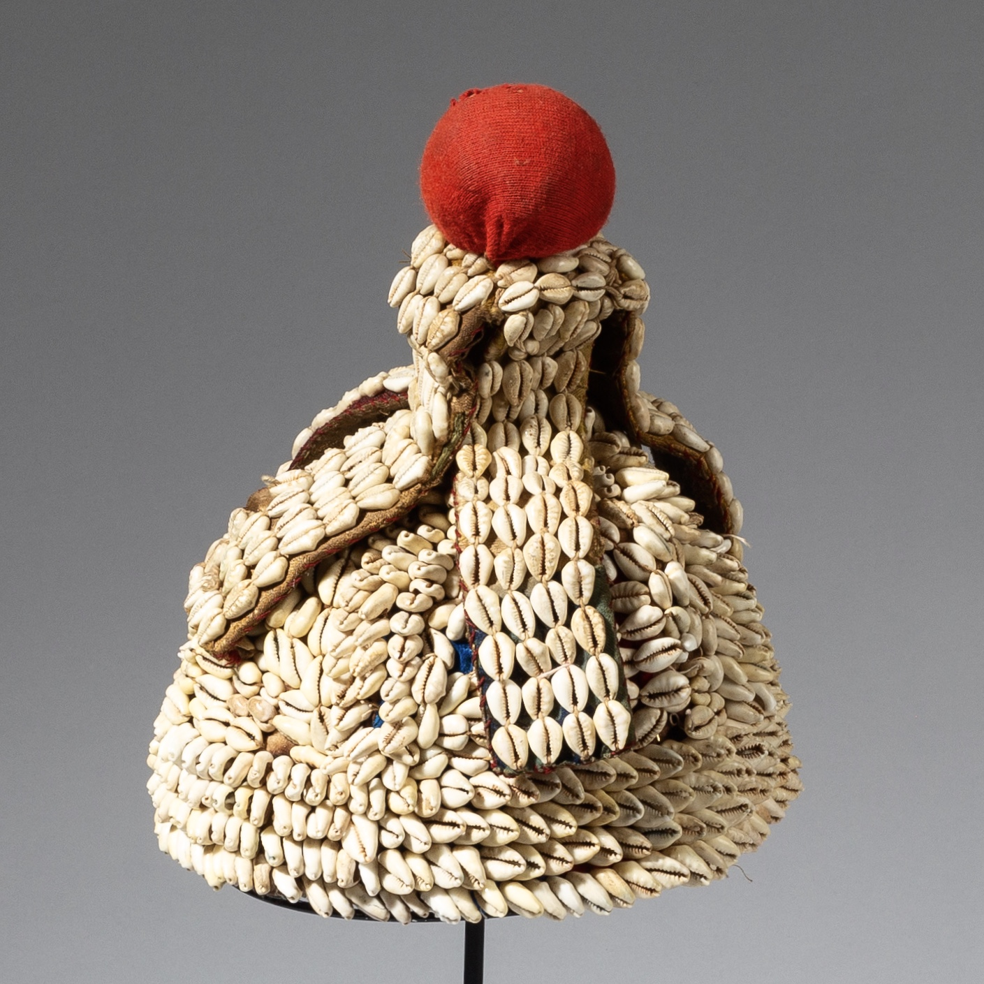 A STUNNING COWRIE ENCRUSTED HAT FROM BURKINA FASO ( No 3131 )
