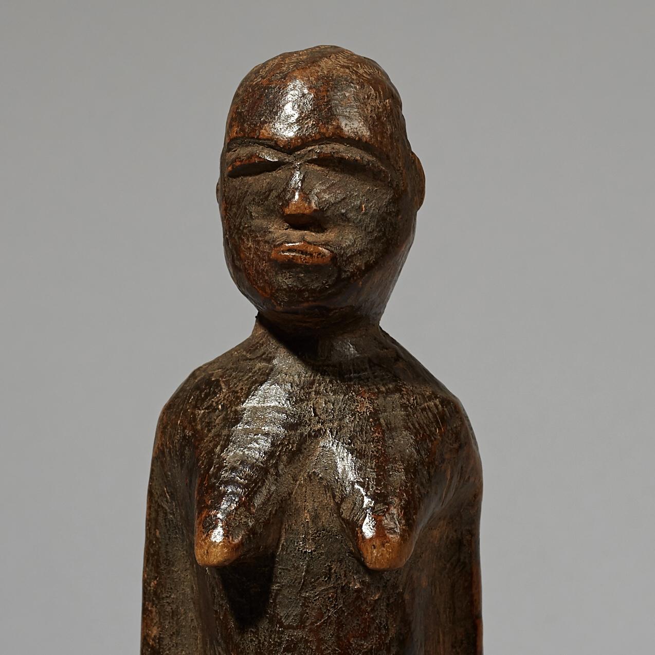 A THIL FIGURE WITH SHEENED PATINA, LOBI TRIBE IVORY COAST W AFRICA ( No 4174 )