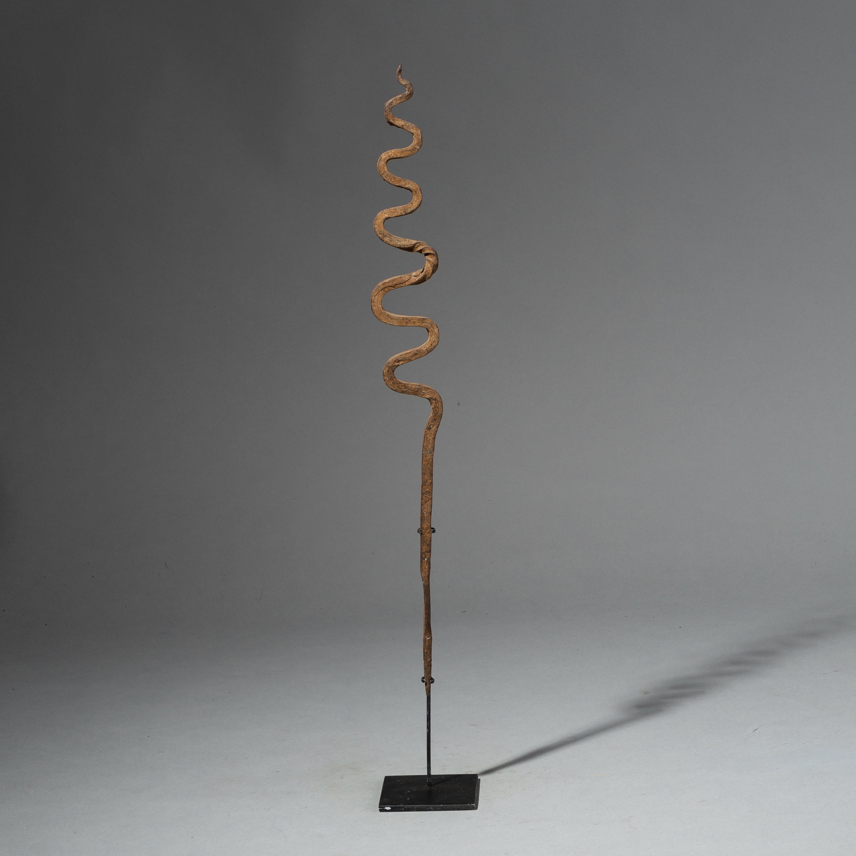 A LONG GENTLY CURVING IRON SNAKE FROM LOBI TRIBE OF BURKINA FASO ( No 2085 )