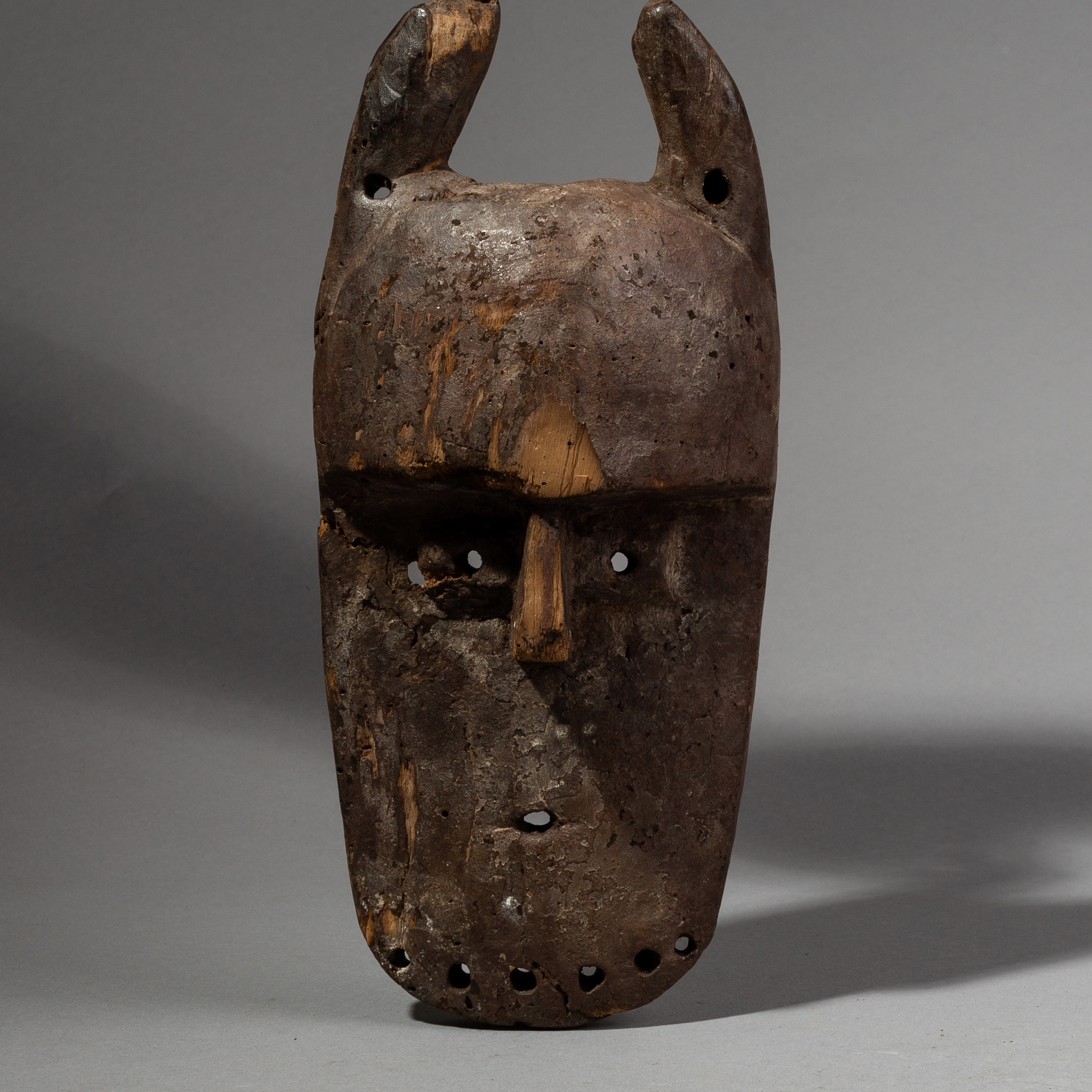 A WELL USED LEGA TRIBE HORNED MASK FROM THE CONGO ( No 2265 )