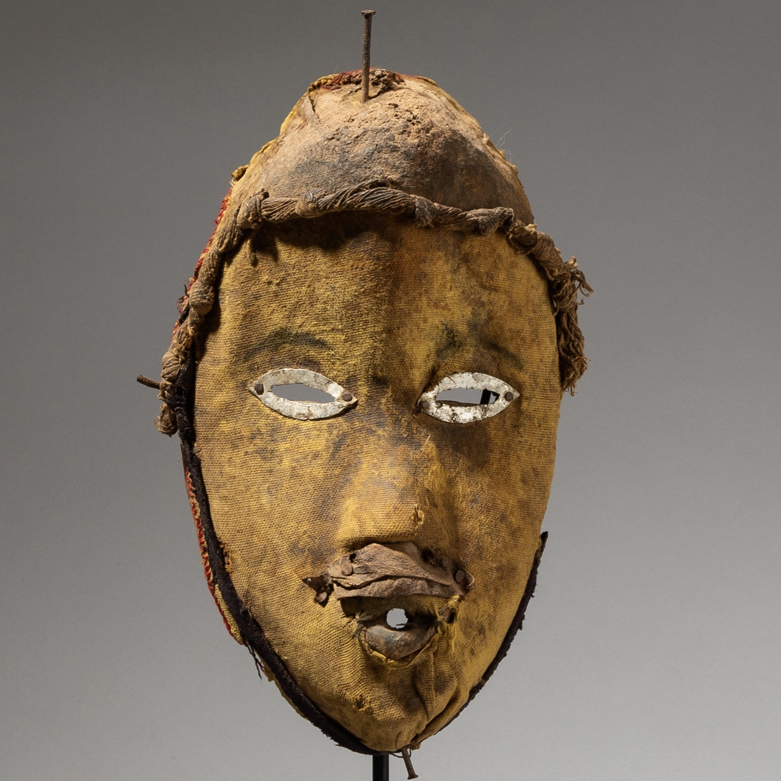 A FABRIC COVERED DAN MASK FROM THE IVORY COAST ( No 4030)