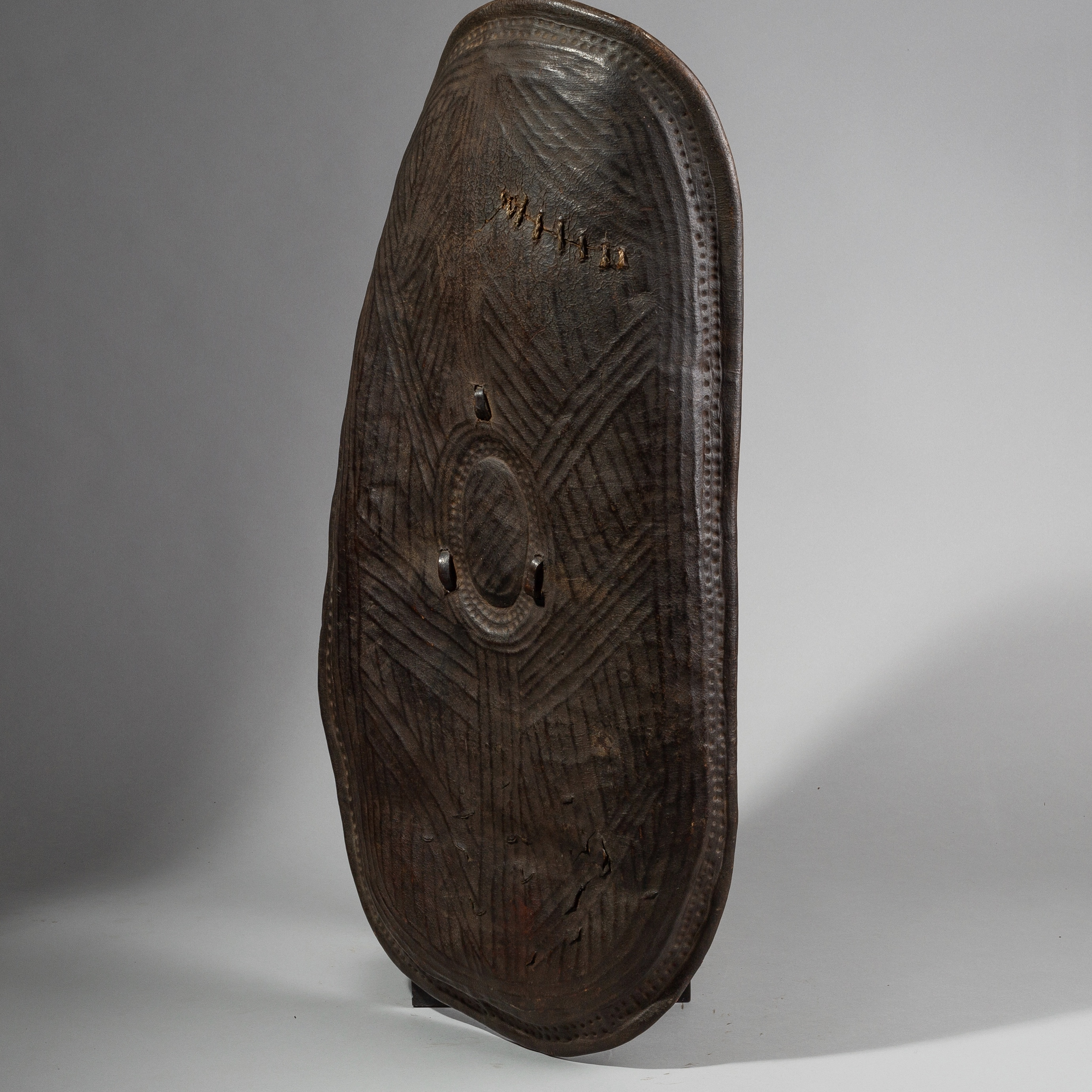 SD AN EXCELLENT EMBOSSED LEATHER  SHIELD FROM BORANA TRIBE ETHIOPIA  ( No 1505 )