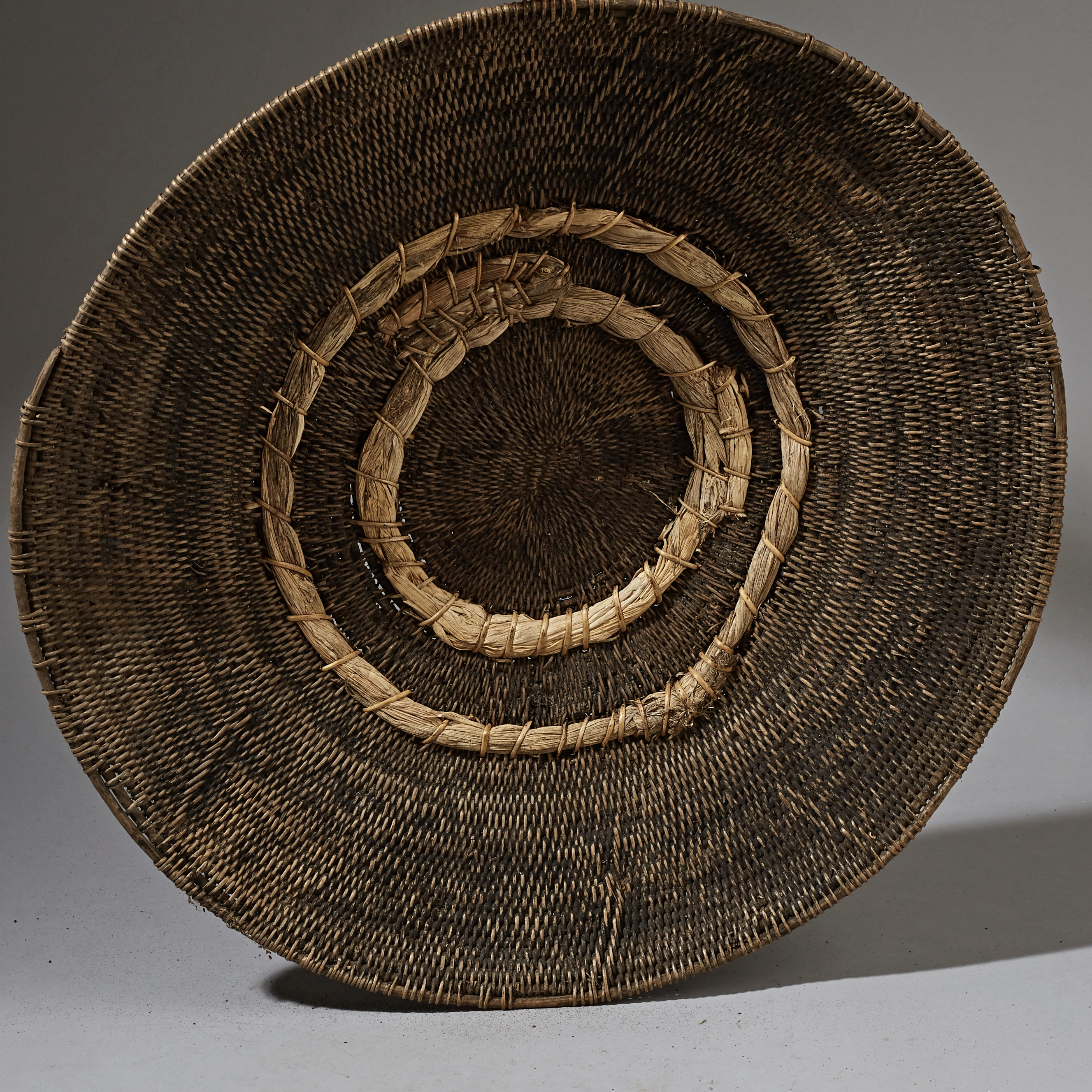 A LARGE HANDWOVEN BASKET WITH INDIGENOUS REPAIRS, ZAMBIA ( No 2565 )