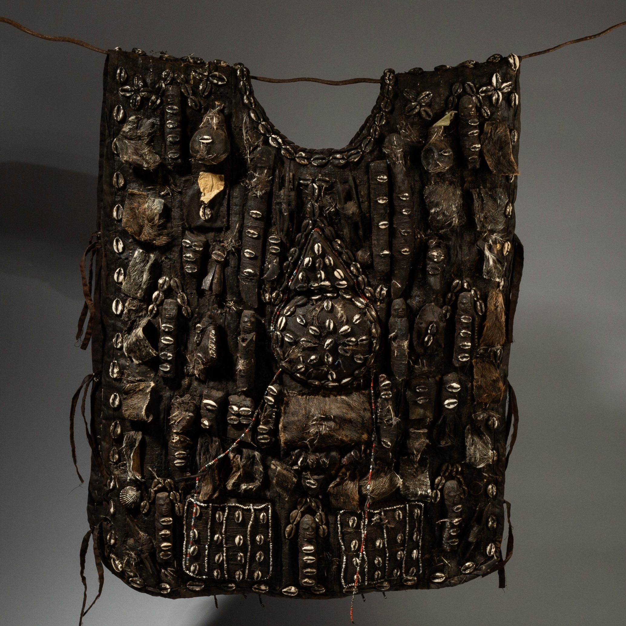 A LARGE FETISH JACKET WITH DIVERSE  TALISMANIC BUNDLES ,+SHELLS, NAGU  TRIBE BENIN ( No 3100 )