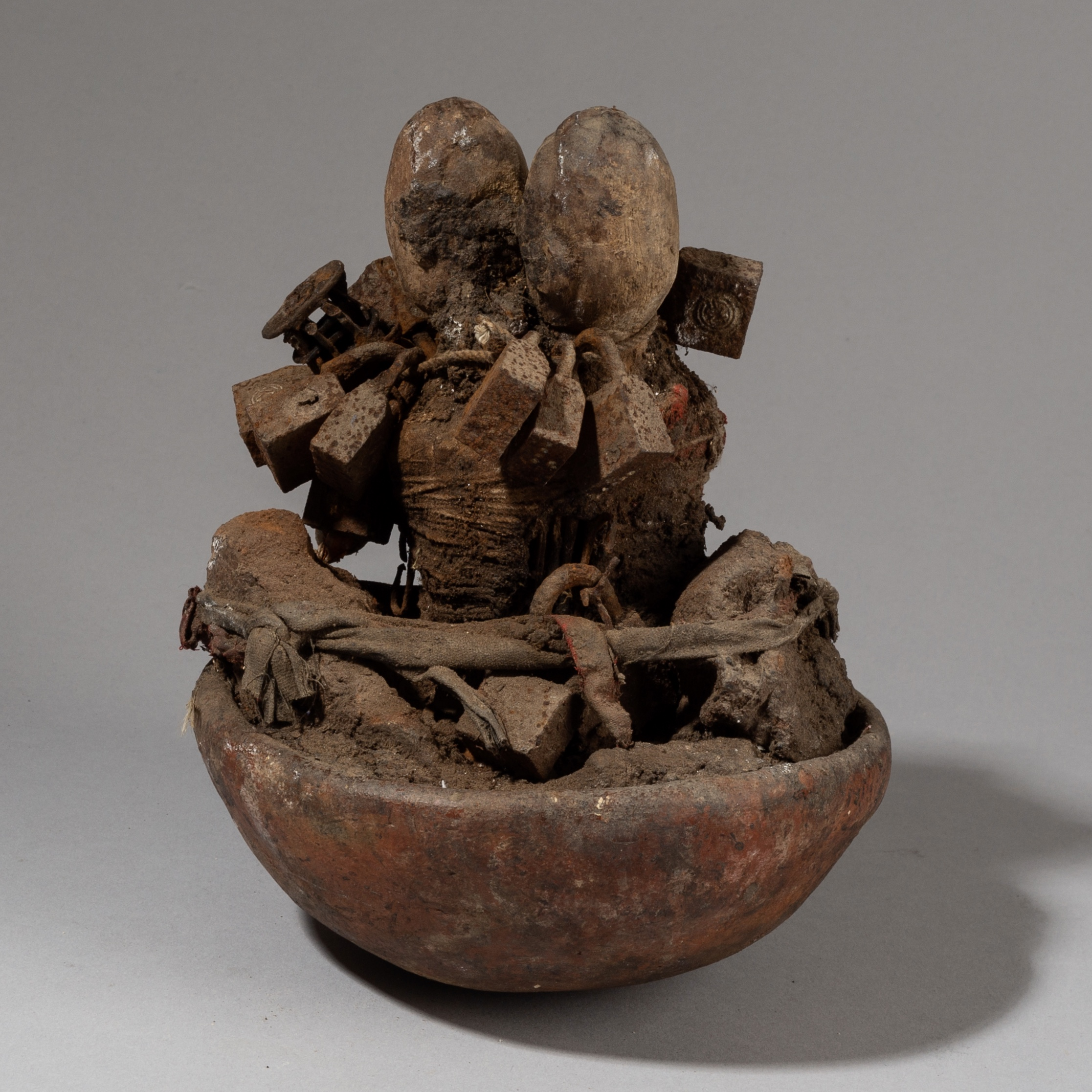 AN UNUSUAL CLAY POT POWER OBJECT WITH LOCKS, EWE TRIBE GHANA ( No 3435 )