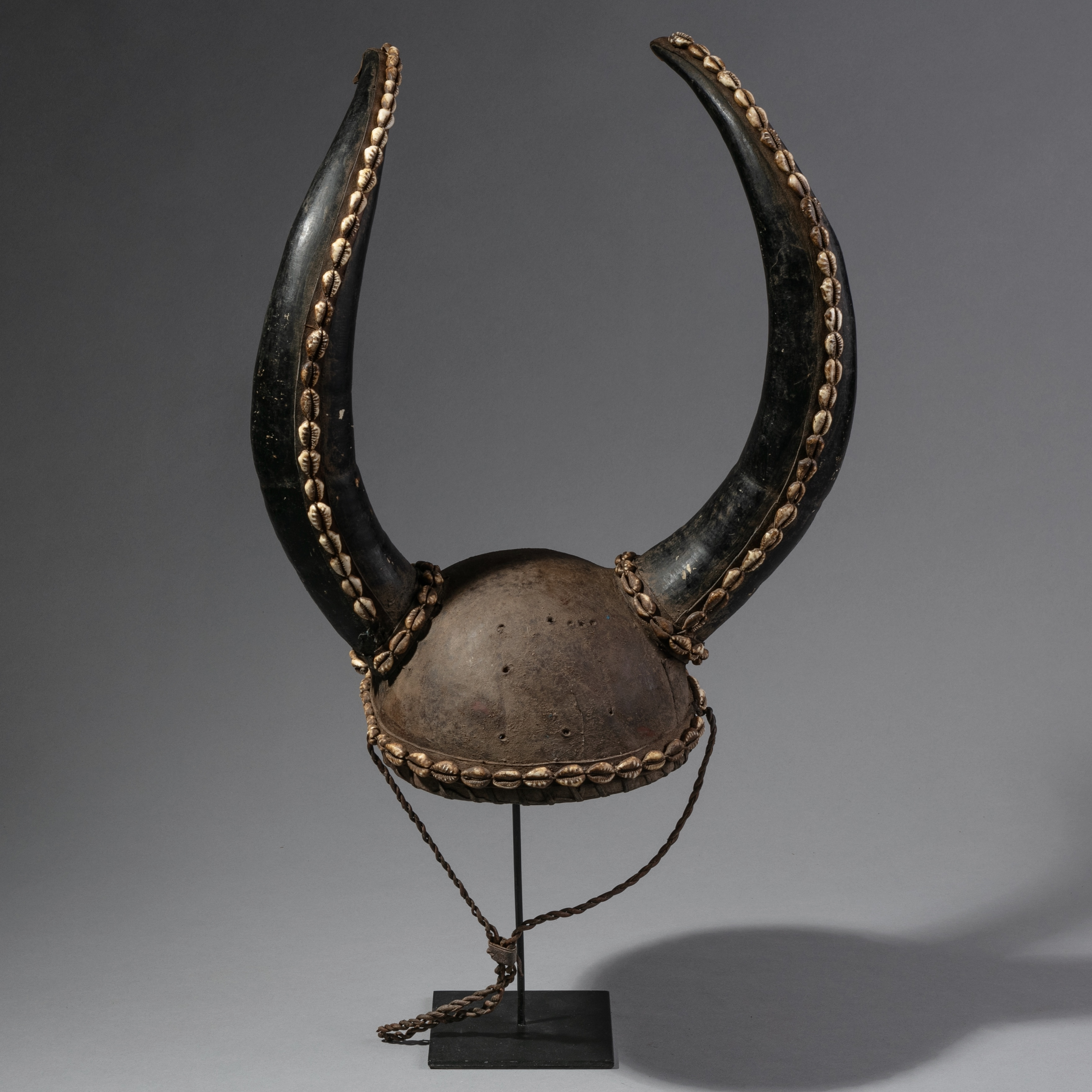 A LEATHER, ANTELOPE HORN AND SHELL HAT FROM MOBA TRIBE TOGO ( No 1145 )